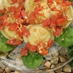 Cheese Ravioli with Fresh Tomato and Artichoke Sauce